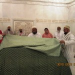 M. Shabbir Bhai offering a Ghilaf at Syedna Hatim (r.a.) from all members of Burhani Guards Pakistan.