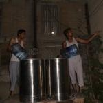 Members Filling Water Bottles